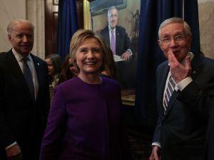 U.S. Senate Minority Leader Sen. Harry Reid , former Secretary of State Hillary Clinton and Vice President Joseph Biden during Reid's leadership portrait unveiling ceremony December 8, 2016 on Capitol Hill in Washington, DC.