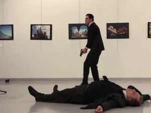 his picture taken on December 19, 2016 shows Andrey Karlov (R), the Russian ambassador to Ankara, lying on the floor after being shot to death by a gunman.