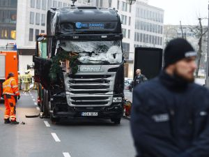 BERLIN, GERMANY - DECEMBER 20: Security and rescue workers tend to the area after a lorry truck ploughed through a Christmas market on December 20, 2016 in Berlin, Germany. So far 12 people are confirmed dead and 45 injured. Authorities have confirmed they believe the incident was an attack and have arrested a Pakistani man who they believe was the driver of the truck and who had fled immediately after the attack. Among the dead are a Polish man who was found on the passenger seat of the truck. Police are investigating the possibility that the truck, which belongs to a Polish trucking company, was stolen yesterday morning.
