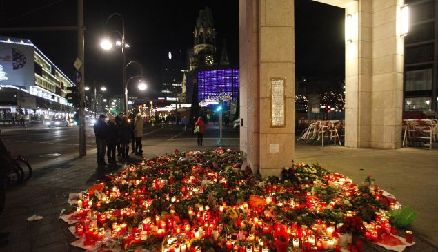 BERLIN, GERMANY - DECEMBER 21: People left flowers and candles to honor the victims of the terrorist attack on a Christmas market.