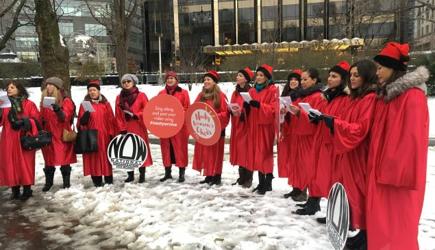 The Nasty Women's Choir sings against President-elect Donald Trump's anti-reproductive rights stance in front of Trump International Hotel.