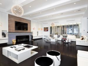 LED backlighting glows through the aluminum fireplace.