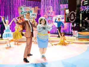 Dove Cameron as Amber Von Tussle, Derek Hough as Corny Collins and Maddie Baillio as Tracy Turnblad in Hairspray Live!.