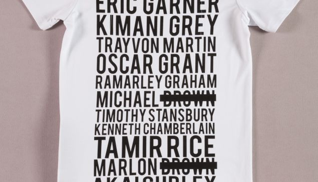 They Have Names t-shirt in white stretch viscose with black printed names at back of 13 unarmed black men killed in police violence; SS zipper