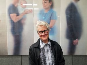 """Ann Hamilton in front of work from her """"ONEEVERYONE"""" series."""