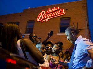 The President greeting people outside Arthur Bryant's Barbeque in Kansas City on July 29, 2014.