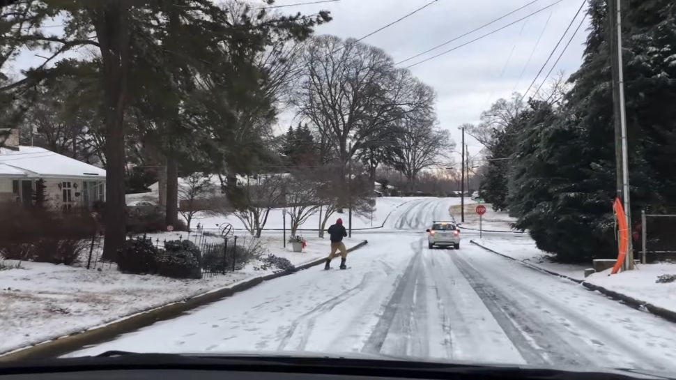 Check Out This Skier Pulled by a Compact Car Over the Icy Roads of Raleigh
