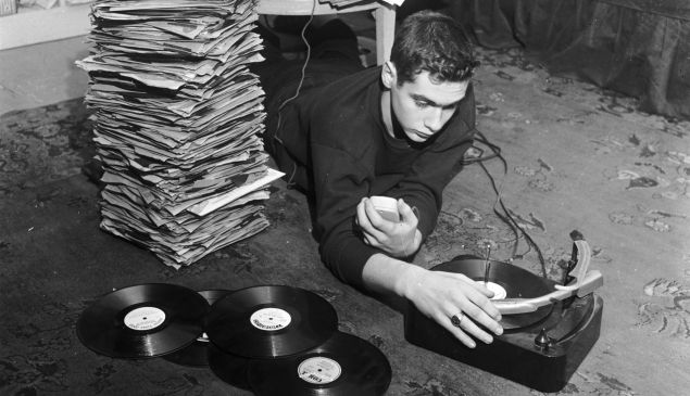 circa 1955: Dean Calagno is one of the youngest radio disc jockeys in America and attracts a large teenage audience. Although he has only one show a week, Dean does a great deal of research during the week to be sure which records are exactly right for his playlist.