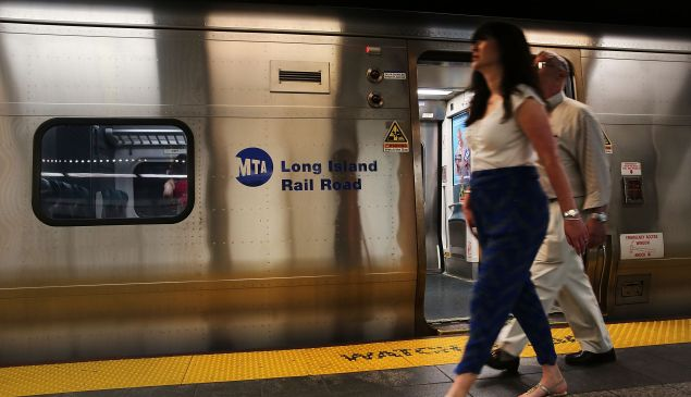NEW YORK, NY - JULY 17: People walk along a Long Island Rail Road (LIRR) platform on July 17, 2014 in New York City. Three days before workers were expected to walk off the job, state officials and union leaders have said that a strike has been averted. New York Gov. Andrew M. Cuomo announced details of the deal saying that it calls for 17 percent raises over six and a half years. Over 300,000 people use the train service on the weekdays. (Photo by Spencer Platt/Getty Images)