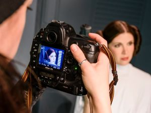 A journalist films a wax figure of the actress Carrie Fisher as the Star Wars character Leia Organa.