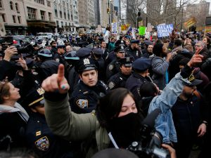 People clash with protesters while they take part in a march against Republican presidential candidate Donald Trump, on March 19, 2016 in New York City. People protest against Trump's policies which threaten the Immigration system and many of the Latino, Black, LGBT, Muslim, and other communities.