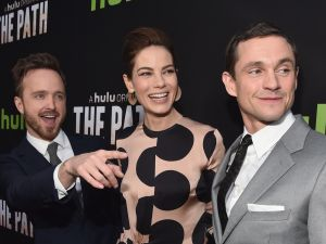 "Actors Aaron Paul, Michelle Monaghan and Hugh Dancy arrive during the premiere of Hulu's ""The Path,"" March 21, 2016."