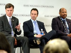 CHICAGO - MARCH 24: (L-R) Alan J. Lacy, vice chairman and CEO of Sears Holdings; Edward S. Lampert, chairman, Sears Holdings; and Aylwin B. Lewis, president of Sears Holdings and CEO of Kmart and Sears Retail, answers following approval of the merger of Sears, Roebuck and Co. and Kmart Holding Corporation by shareholders of both companies March 24, 2005in Hoffman Estates, a suburb of Chicago, Ilinois. The new company, Sears Holdings Corporation, is expected to begin trading on the Nasdaq national market next week.