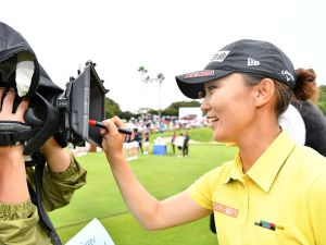 MIHAMA, JAPAN - SEPTEMBER 18: Teresa Lu of Taiwan signs an autograph on the TV camera after winning the during the Final round of the Munsingwear Ladies Tokai Classic 2016 at the Shin Minami Aichi Country Club Mihama Course on September 18, 2016 in Mihama, Japan. (Photo by Arrow Press/Getty Images)