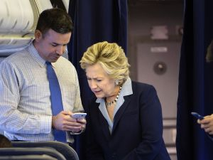 Hillary Clinton with national press secretary Brian Fallon on her plane on October 3, 2016.
