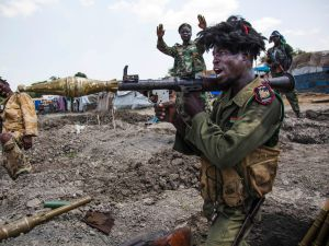 Soldiers of the Sudan People Liberation Army (SPLA) celebrate while standing in trenches in Lelo, outside Malakal, South Sudan