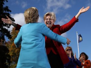 U.S. Sen. Elizabeth Warren greets democratic presidential nominee former Secretary of State Hillary Clinton during a campaign rally at Saint Anselm College on October 24, 2016 in Manchester, New Hampshire.