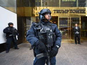 NYPD officers stand guard outside Trump Tower.