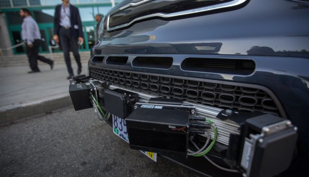 Radar sensors are seen on a car equipped with LIDAR, radar, cameras and GPS units using PolySync autonomy system development for creating and deploying driverless vehicles.