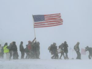 "Despite blizzard conditions, military veterans march in support of the ""water protectors"" on the edge of the Standing Rock Sioux Reservation."