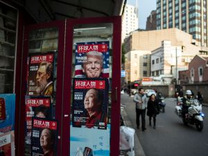 This picture taken on December 14, 2016 shows a advertisement for a magazine (top R) featuring US President-elect Donald Trump on the cover at a newsstand in Shanghai.