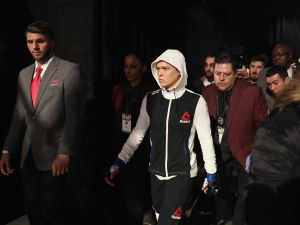 LAS VEGAS, NV - DECEMBER 30: Ronda Rousey walks to the Octagon to face Amanda Nunes of Brazil in their UFC women's bantamweight championship bout during the UFC 207 event on December 30, 2016 in Las Vegas, Nevada. (Photo by Christian Petersen/Getty Images)