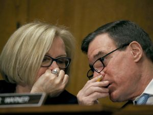 Sen. Claire McCaskill talks with Sen. Mark Warner during the confirmation hearing of Treasury Secretary nominee, Steven Mnuchin, on January 19, 2017.