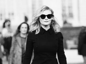 Kirsten Dunst heads to the Christian Dior Couture show.