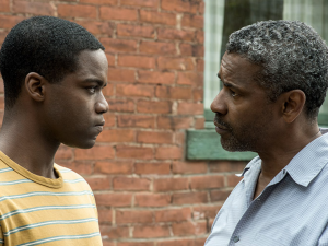 Jovan Adepo and Denzel Washington in Fences.