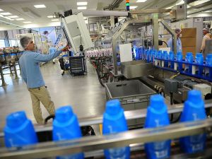 A Romanian employee surveys a production line at a Procter & Gamble plant in Bucharest.