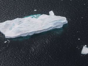 ANTARCTICA - OCTOBER 27: An iceberg floats near the coast of West Antarctica as seen from a window of a NASA Operation IceBridge airplane on October 27, 2016 in-flight over Antarctica. NASA's Operation IceBridge has been studying how polar ice has evolved over the past eight years and is currently flying a set of 12-hour research flights over West Antarctica at the start of the melt season. Researchers have used the IceBridge data to observe that the West Antarctic Ice Sheet may be in a state of irreversible decline directly contributing to rising sea levels. NASA and University of California, Irvine (UCI) researchers have recently detected the speediest ongoing Western Antarctica glacial retreat rates ever observed. The United Nations climate change talks begin November 7 in the Moroccan city of Marrakech.