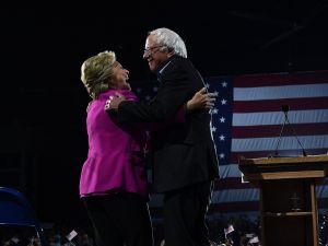 Hillary Clinton embraces Sen. Bernie Sanders.