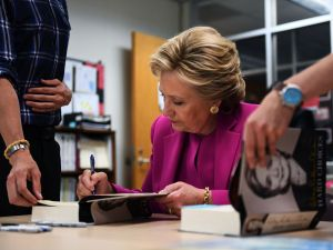 Hillary Clinton signs copies of her books for her supporters.