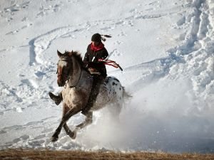 Native American activist rides down a ridge which overlooks Oceti Sakowin Camp on the edge of the Standing Rock Sioux Reservation on December 4, 2016 outside Cannon Ball, North Dakota.