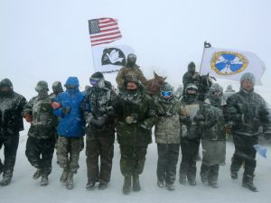 A large group of military veterans join Native Americans and activists from around the country to try to halt the construction of the Dakota Access Pipeline.