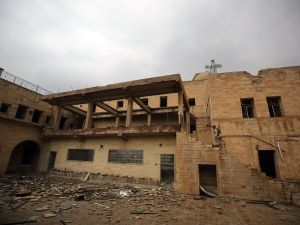 An Iraqi soldier inspects the debris at St. George's Monastery, a historical Chaldean Catholic church, in Mosul, which was destroyed by Islamic State (IS) group in 2015.