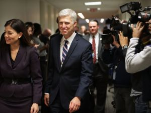 WASHINGTON, DC - FEBRUARY 01: Supreme Court nominee Judge Neil Gorsuch (C) is accompanied by former Republican Sen. Kelly Ayotte (L) as they arrive for a meeting at the office of Sen. Joe Manchin (D-WV) in the Hart Senate Office Building on Capitol Hill February 1, 2017 in Washington, DC. President Donald Trump nominated Judge Gorsuch to the Supreme Court to fill the seat left vacant with the death of Associate Justice Antonin Scalia in February 2016.