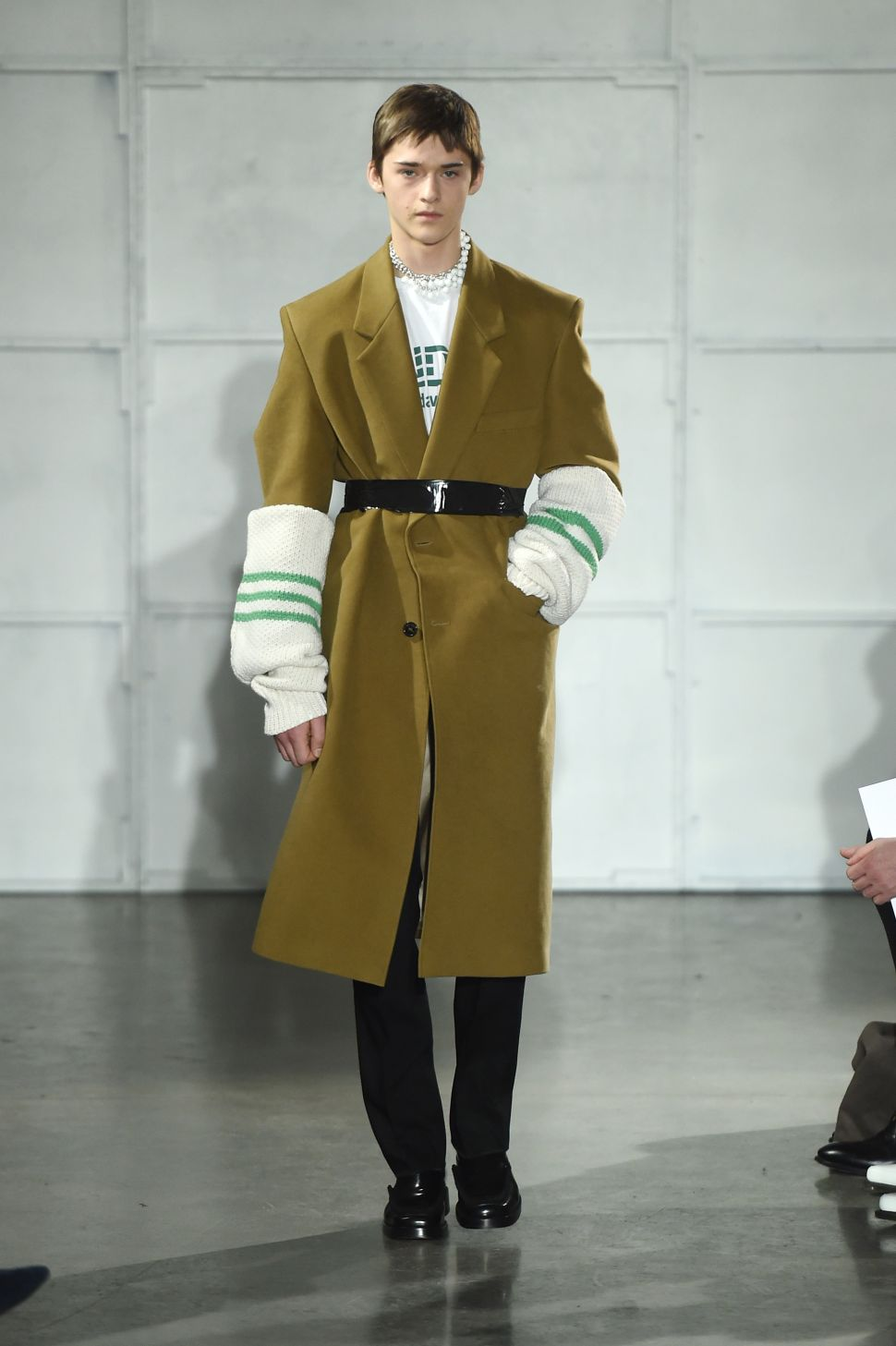 Raf Simons Graces NYC With Graphic Duct Tape and Arm Warmers