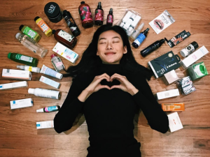 Model Jessie Li Wang posing with her favorite beauty products