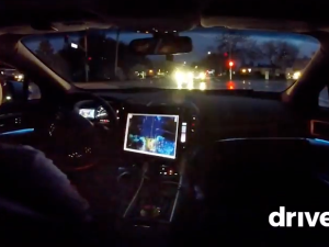 A Drive.ai self-driving car navigates wet California roads at night.