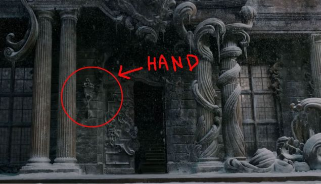 There's a hand holding the lantern at the castle's front door—I swear!