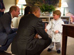 LONDON, ENGLAND - APRIL 22: In this handout provided by The White House, President Barack Obama, Prince William, Duke of Cambridge and First Lady Michelle Obama talks with Prince George at Kensington Palace on April 22, 2016 in London, England. The President and his wife are currently on a brief visit to the UK where they attended lunch with HM Queen Elizabeth II at Windsor Castle and later dinner with Prince William and his wife Catherine, Duchess of Cambridge at Kensington Palace. Mr Obama visited 10 Downing Street this afternoon and held a joint press conference with British Prime Minister David Cameron where he stated his case for the UK to remain inside the European Union. (Photo by Pete Souza/The White House via Getty Images)