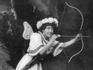 circa 1910: Ethel Allandale plays Cupid in the show 'Love's Garden'. (Photo by Hulton Archive/Getty Images)