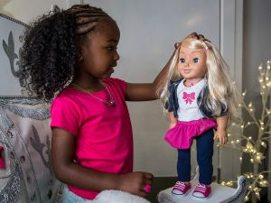 LONDON, ENGLAND - JUNE 26: Jayla, aged 4, plays with a 'My Friend Cayla' doll in the Hamleys toy shop on June 26, 2014 in London, England. The doll, which uses Bluetooth technology to connect to Android and iOS devices, retails for 75 GBP and is included in Hamleys' predictions for the top selling toys for Christmas 2014. (Photo by Rob Stothard/Getty Images)