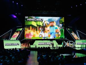 "Mojang's ""Director of Fun"" Lydia Winters speaks about 'Minecraft' during a press conference."