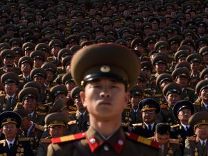 North Korean soldiers stands before spectators during a mass military parade at Kim Il-Sung square in Pyongyang on October 10, 2015.