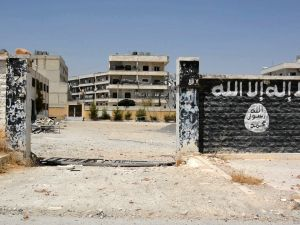 An image grab taken from an AFP video dated from August 12, 2016 shows a school that was used by Islamic State (IS) group's fighters to manufacture explosives in the northern Syrian town of Manbij, almost a week after the Syrian Democratic Forces (SDF), a coalition of Arab and Kurd fighters, seized the group's stronghold. / AFP / STR