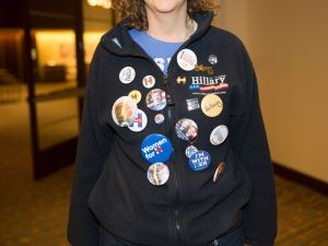 A Hillary Clinton supporter wears patriotic buttons during a Dallas, Texas, Democrat watch party on November 8, 2016. Hillary Clinton and Donald Trump were locked in a dead heat Tuesday in their historic clash for White House, as the world waited anxiously for results from the key battleground states that will decide the winner. / AFP /