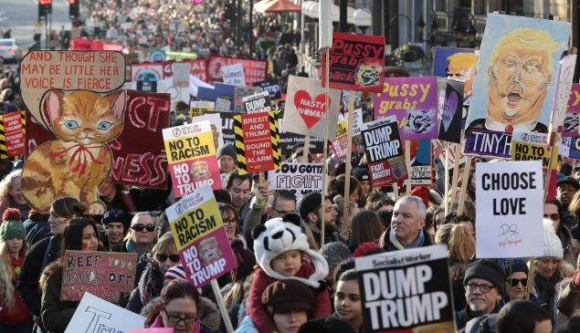 Protesters make their way through the streets of London during the Women's March on January 21, 2017 in London, England.
