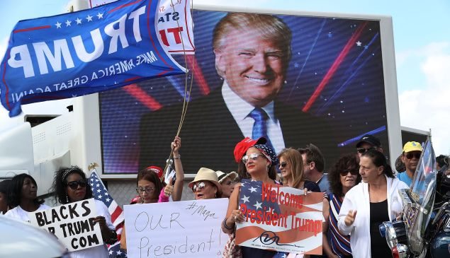 People show their support for President Donald Trump on March 4, 2017 in West Palm Beach, Fla.